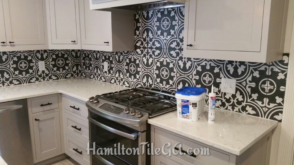 A superb merola tile back splash in Roswell, GA . An upgraded splash with  Mapei's FlexColor  single component grout, stain free and waterproof, w/  Mapesil full silicone caulking .  Ardex X5  thin set with  Merolatile  Demand the competition provide you with quality installation products!