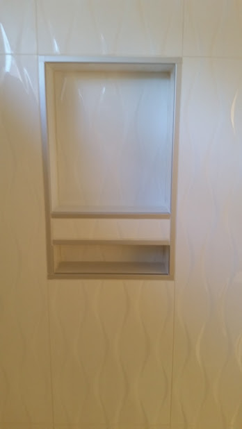 A sleek inset box edged with Schluter Quadec profiles.