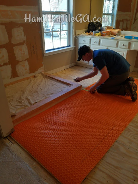 Another Ditra Heat system going in... Warm up your toes every morning and simultaneously increase the comfort and enjoyment of your bathroom routine!