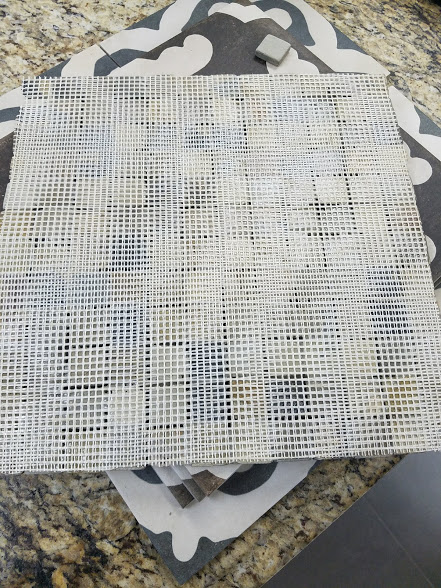 Do you think any of the thin set gets through this double mesh to touch any of the tile? Do you think any of the thin set gets through the double mesh to lock the tile in place? The answer is no. We send this material back.