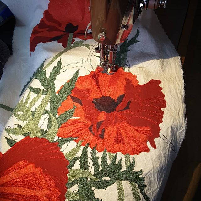 Adding stitch to the poppies. #bigredpoppies #singersewingmachine  #freemotionembroidery  #drawingwithstitch #paintingwithfabric