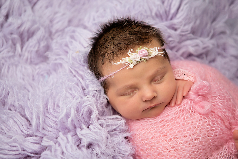Wrapped baby girl pink and lavender photo session idea for newborns photographer near me