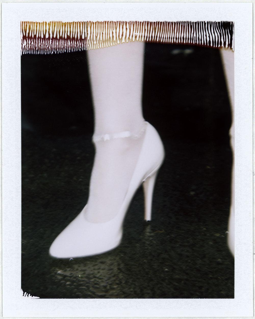 Zapato de GUCCI y brazalete de GIANVITO ROSSI