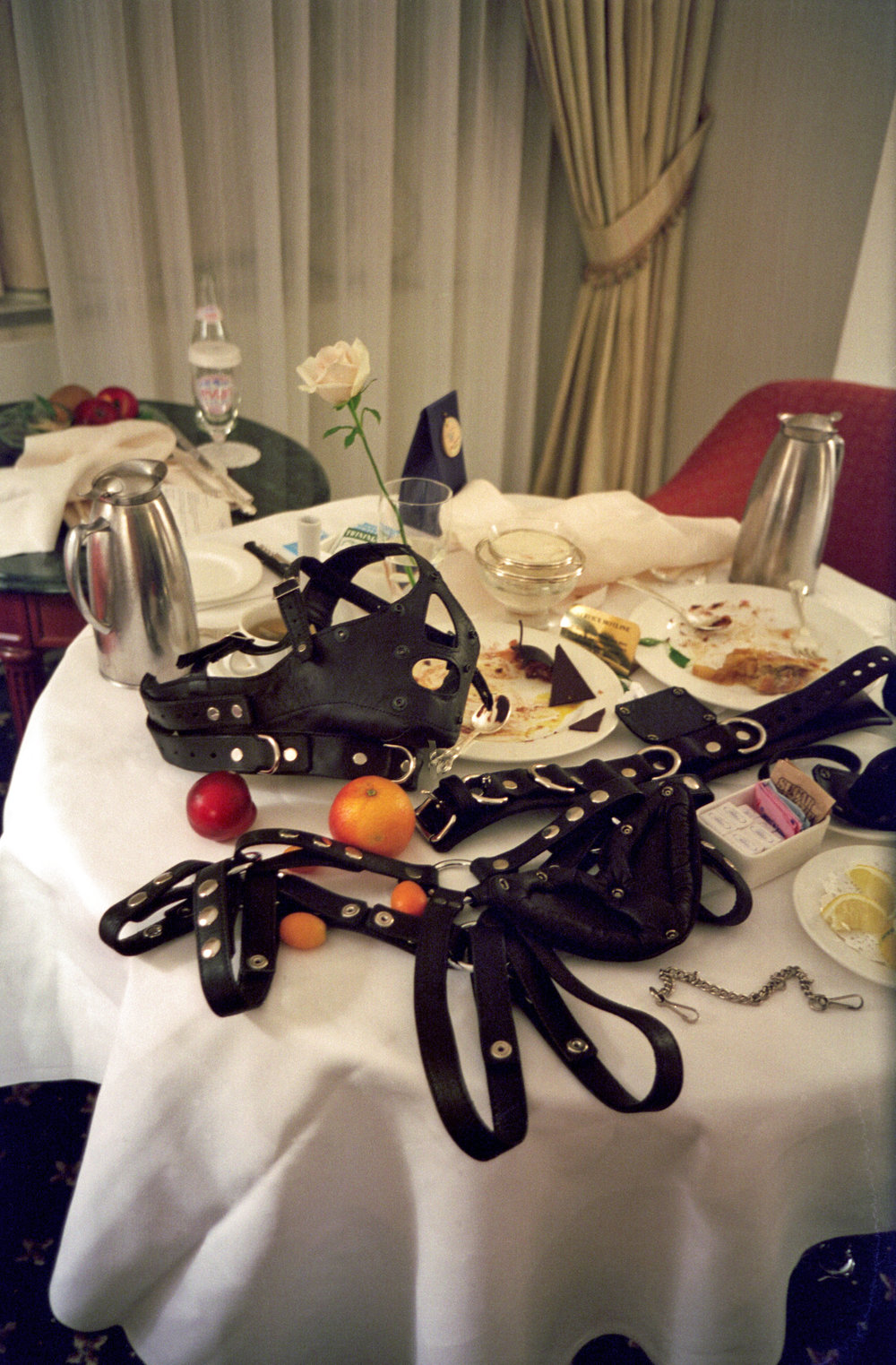 SLAVA MOGUTIN  (1974)  No Love Series: Dinner for 2 (Still life with the Bishop Mask) , 1999, impresión cromogénica de archivo, 76.2 x 50.8