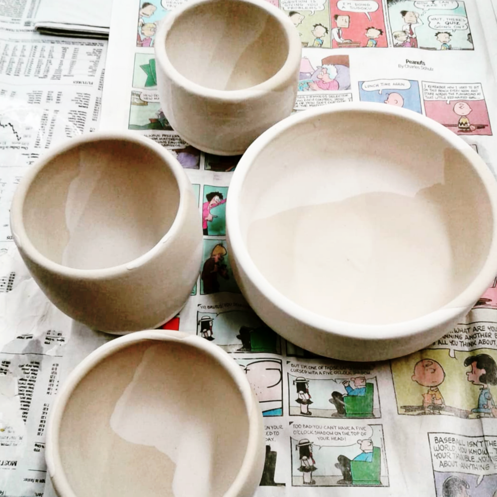 Glazed white celadon and blue rutile mugs and bowls.  Artistic pottery accents made for the home and restaurants in Austin, Texas by Little Clay Studio.