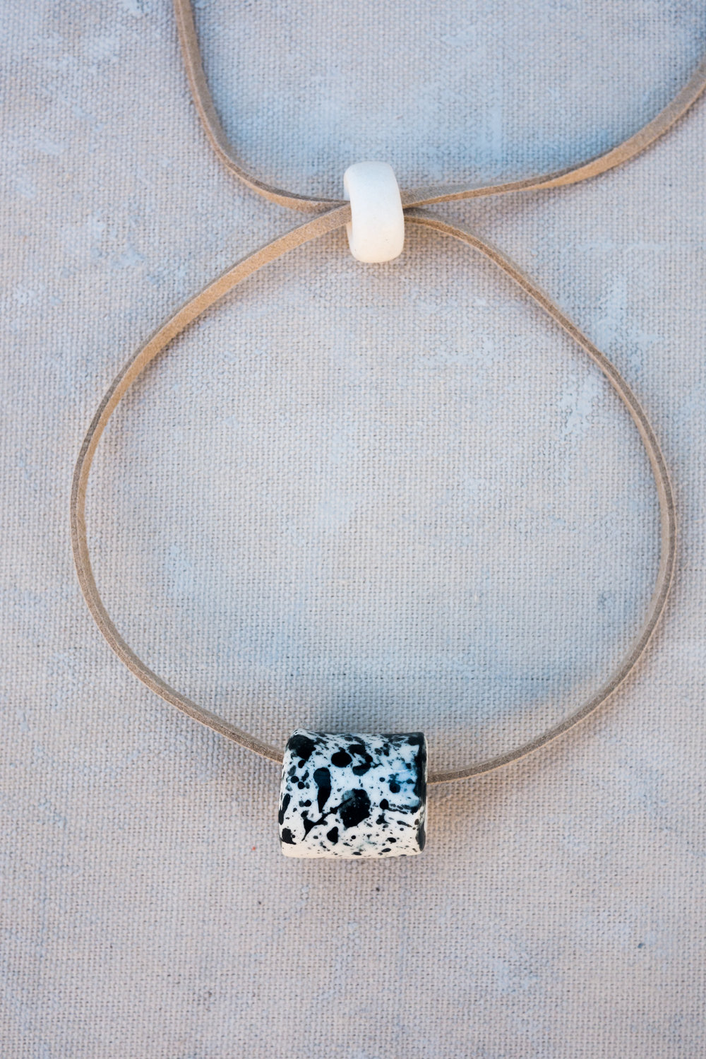 Black Ink Tubular Necklace made with porcelain clay by Little Clay Studio in Austin, Texas.