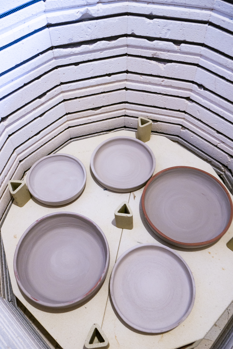 Glaze firing oversized speckled bowls in the ceramics kiln | Little Clay Studio, Austin, Texas
