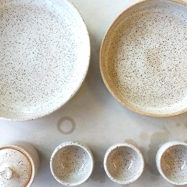 Speckled white and beige bowls made on the pottery wheel by Little Clay Studio in Austin, Texas. Simplistic, minimal design made by hand by an independent artist and woman-owned business. Beautiful bowls for food photography, blogs, Instagram. Inspired by Madewell, Anthropologie, Kinfolk and Domino magazine. Artistic, painterly glazes for boutiques, independent shops, cafes, restaurants, food blogger, interior design. Tableware decor for everyday, parties. Generous sizes for serving.