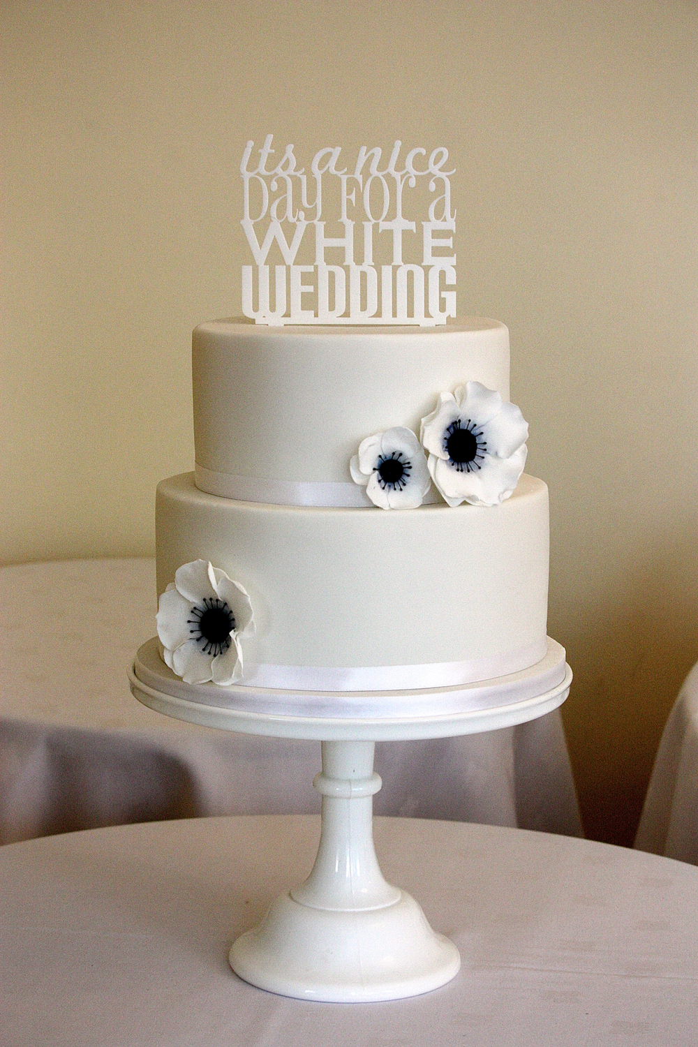 White anemone wedding cake