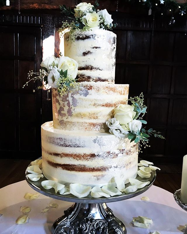 Congratulations to Z&J marrying @greatfosters today! Semi naked tiers of white chocolate, lemon polenta and carrot, embellished with silver leaf for a wintery feel! Flowers from @fineflowersco