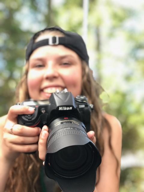 Izzy with camera.JPG