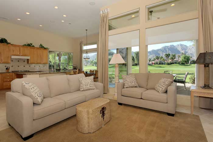 This PGA West La Quinta luxury homes great room offers sweeping mountain views