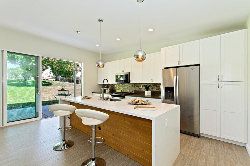 Miles kitchen pro shot for MLS looking out slider.jpeg
