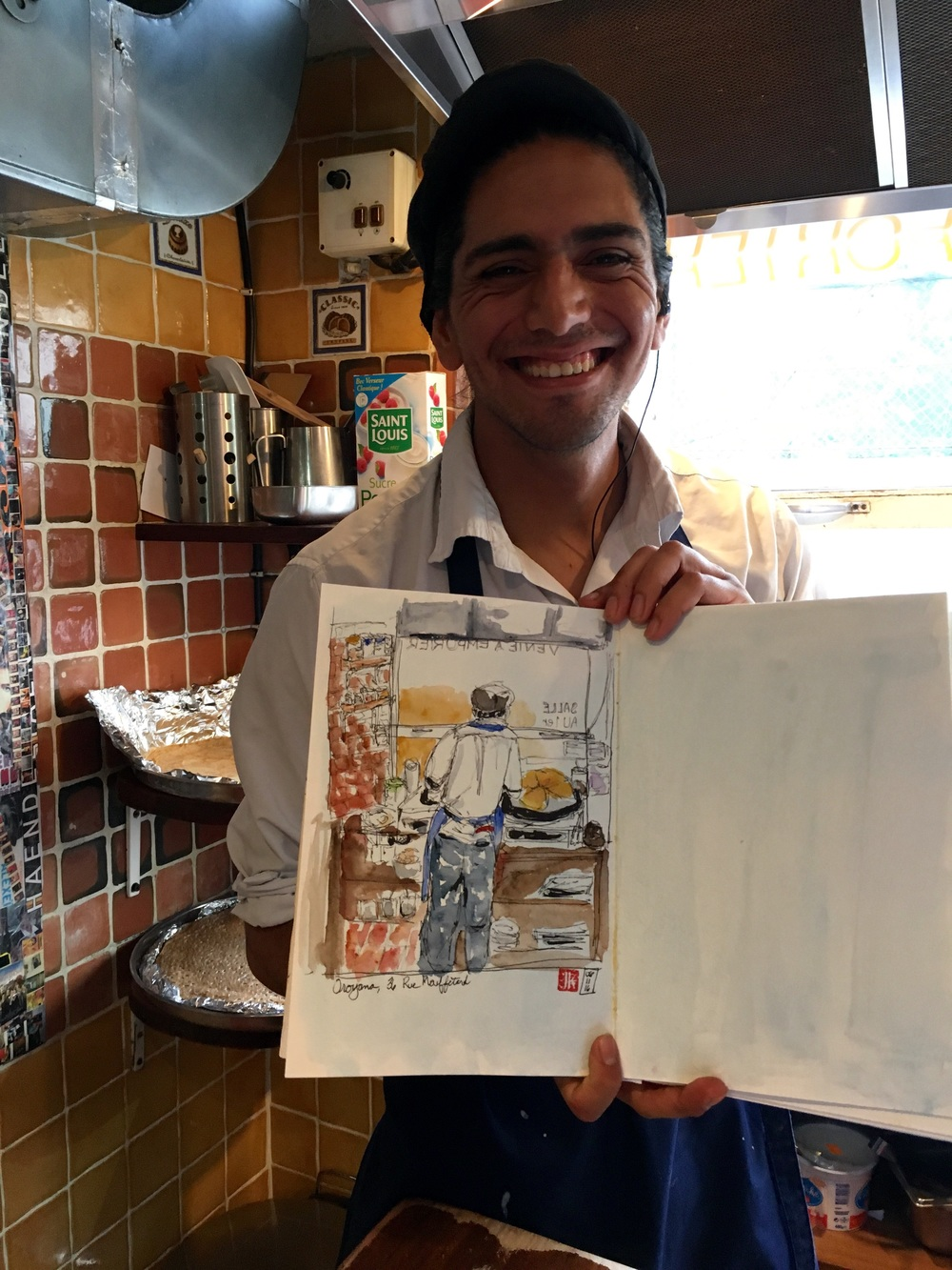 The happy cook posing with my drawing