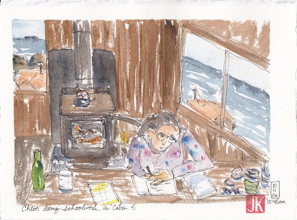 Chloe doing her schoolwork in the cabin
