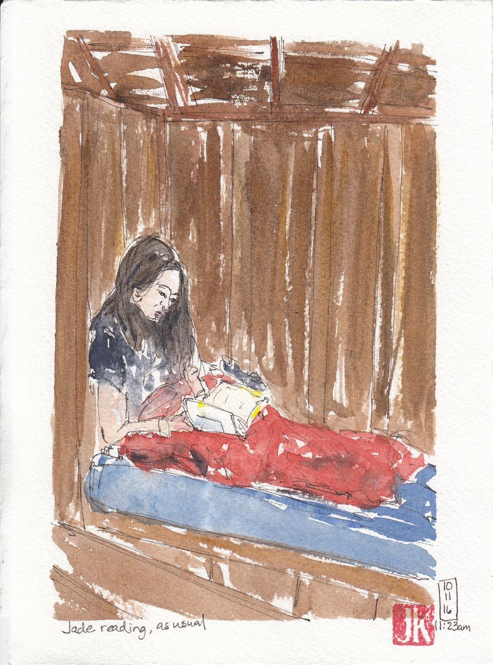 Jade reading in her bed in the main cabin room