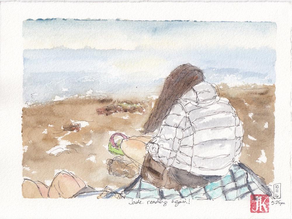 Jade reading on the beach - again