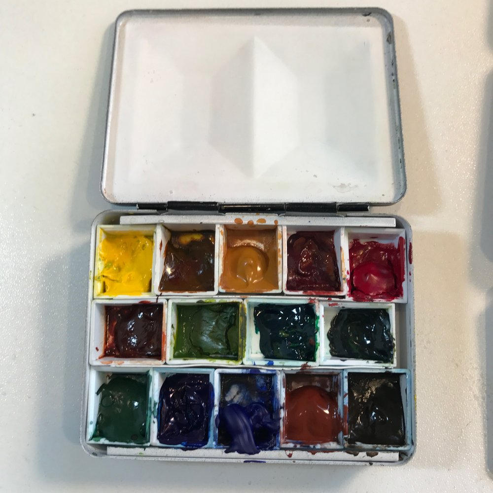 """My 3.25"""" x 2.5"""" tiny metal palette filled with Daniel Smith watercolors"""