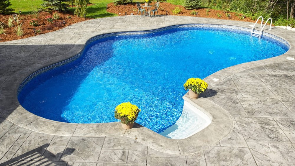 Poolscaping Decking and Design - Add personality and style to your outdoor living space. A beautifully designed pool deck that will take your outdoor space to the next level.