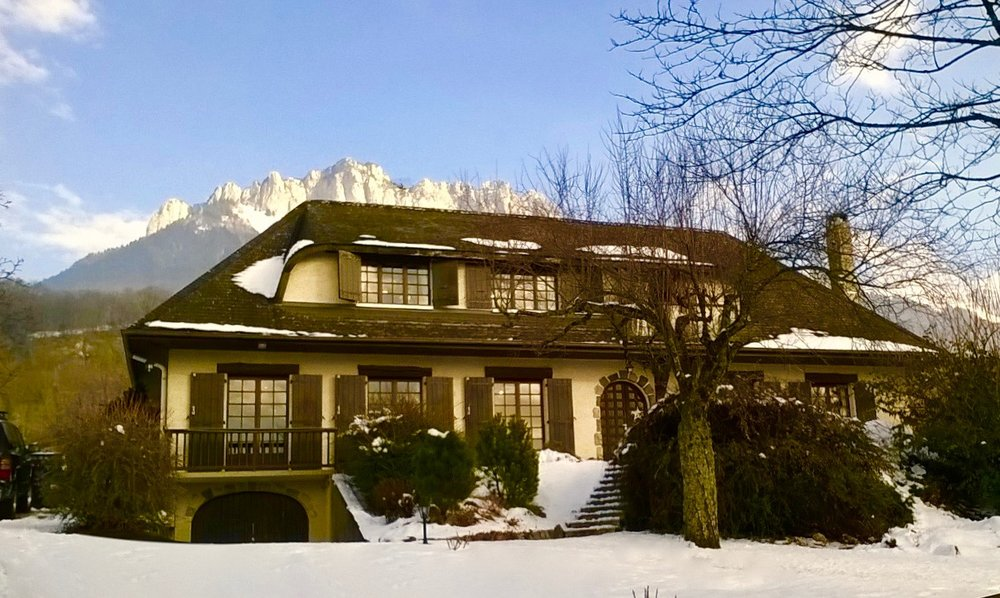 The front view of the house with panoramic views of the Alps on the back deck.
