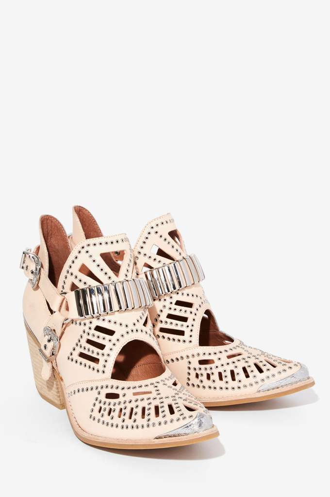 Jeffrey Campbell Calhoun Ankle Boot - Beige I used to be so focused on collecting statement bags that I tended to forget about the statement shoe. Never again. The right shoe can have such an impact on your entire outfit. Wear a white sundress with flip flops and you've got a laid back summer look; wear the same dress with these booties and you're suddenly an urban gypsy. Throw on a wide brimmed fedora and get ready to get noticed. These boots are ridiculous, I need them now.
