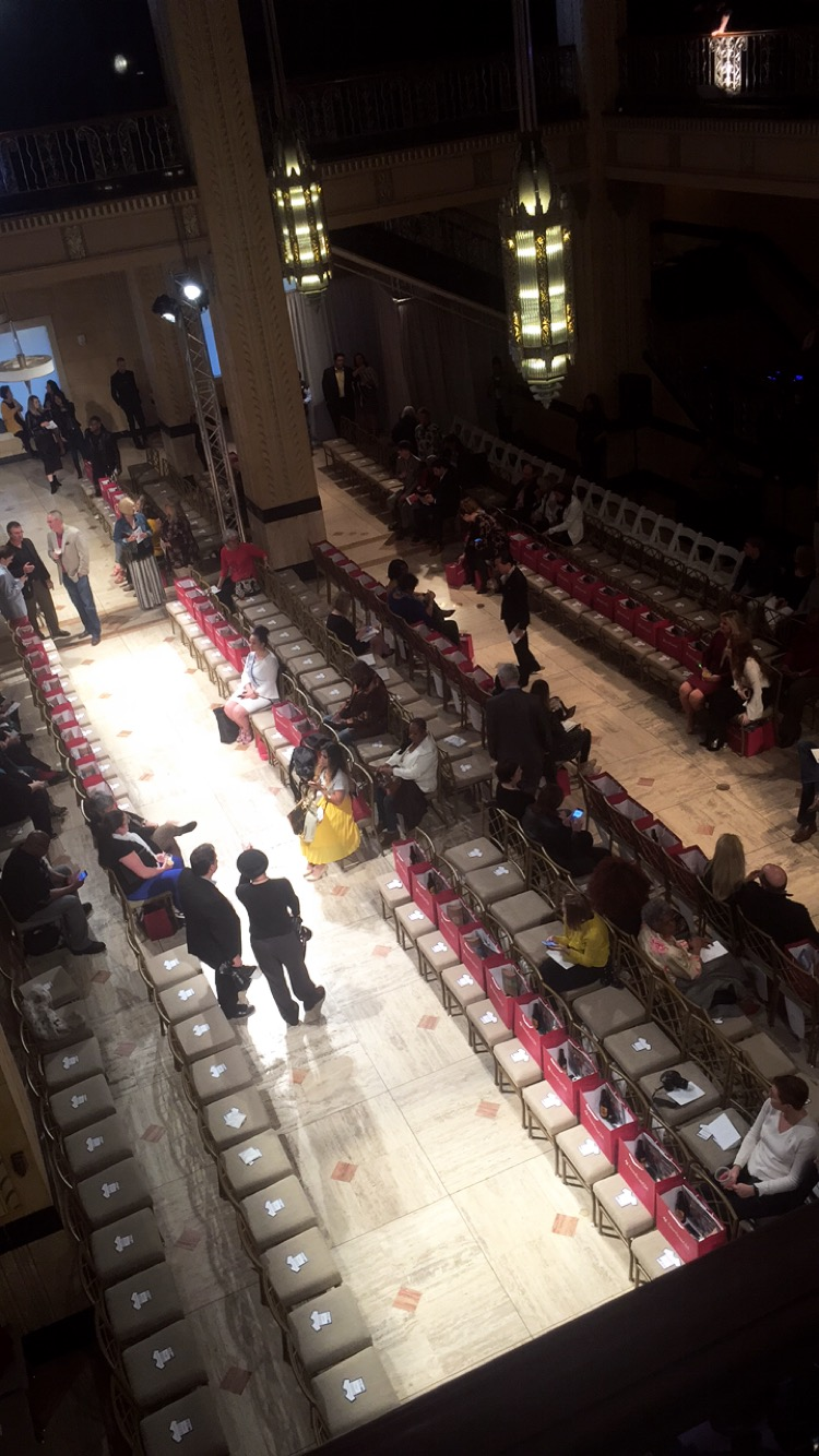 Guests take their seats by the European Style runway at The Grand Hall