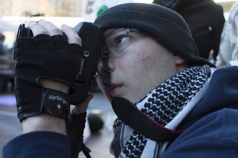 Nelson photographs the second annual Black Friday Black Lives Matter protest in Seattle on Nov. 26, 2015.