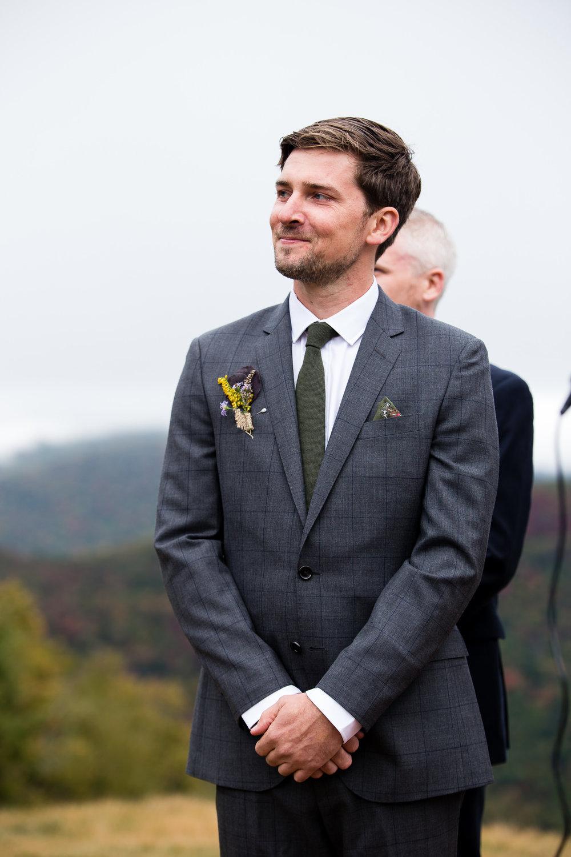 groom-sees-bride-walking-up-aisle