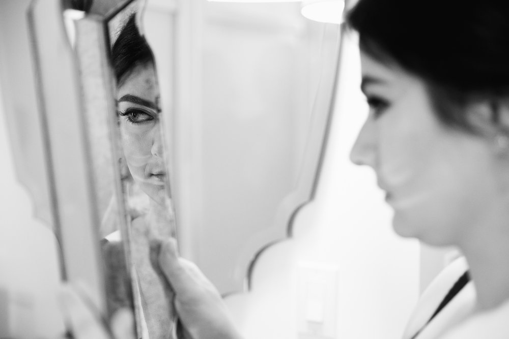 Bride checks out her hair and make-up during prep at the Nomo Soho Hotel before her Housing works wedding.