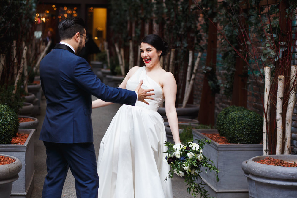Bride and groom have their first look in front of the Nomo Soho Hotel in NYC.