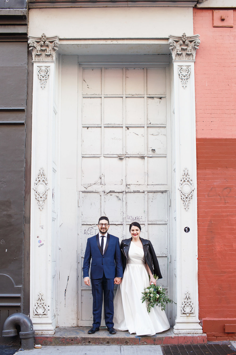 Bride and Groom in front of a white painted door in soho new york city