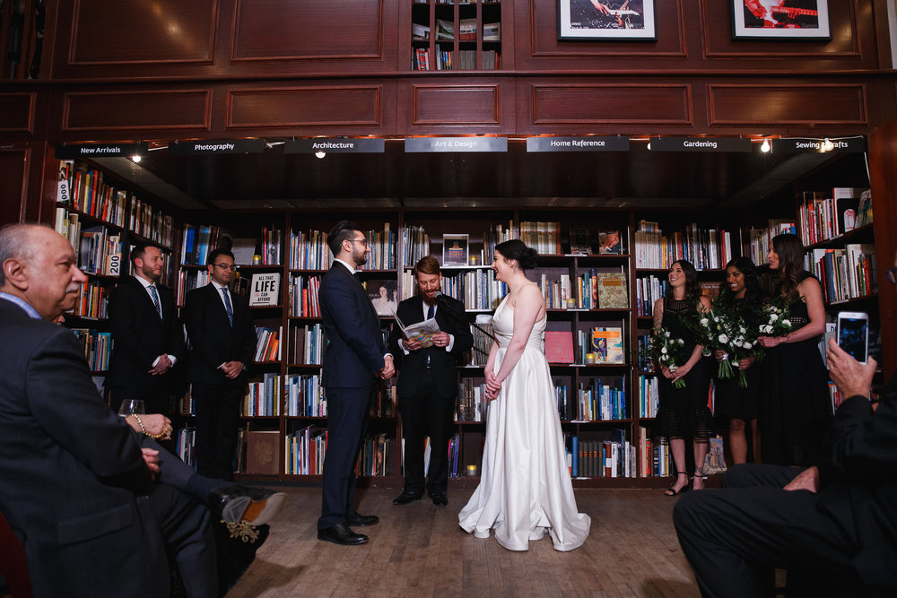 Wedding ceremony in the stacks at the housing works bookstore