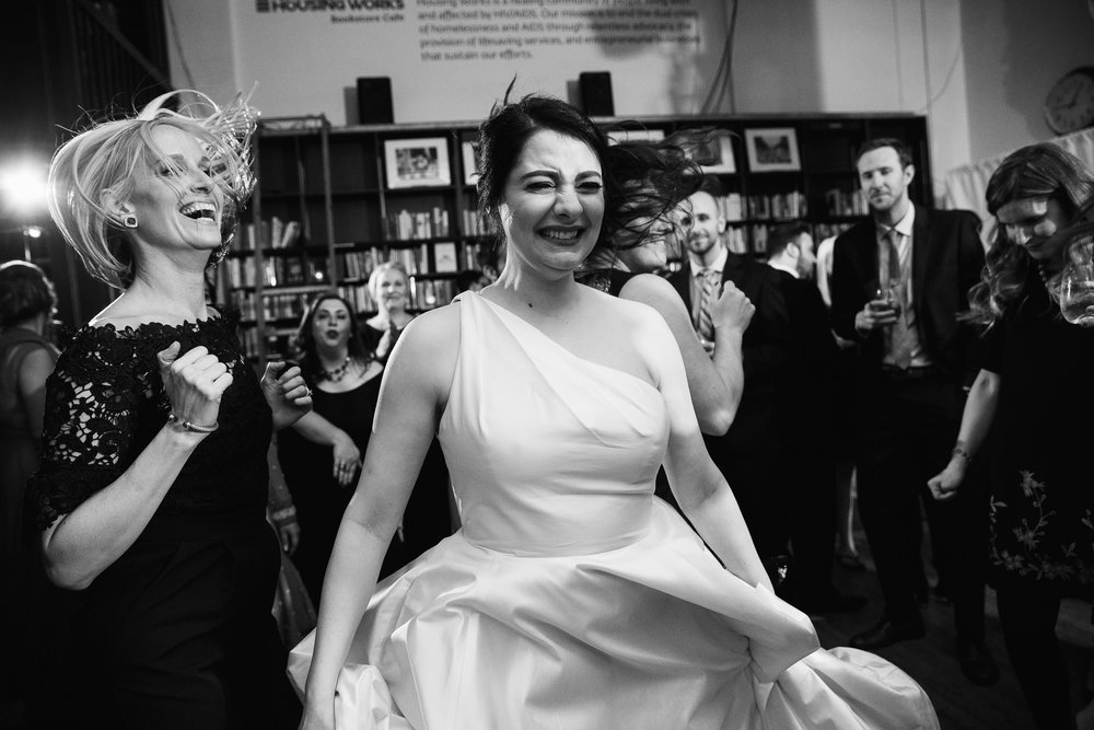 bride's dress spins as she jumps and dances on the dancefloor