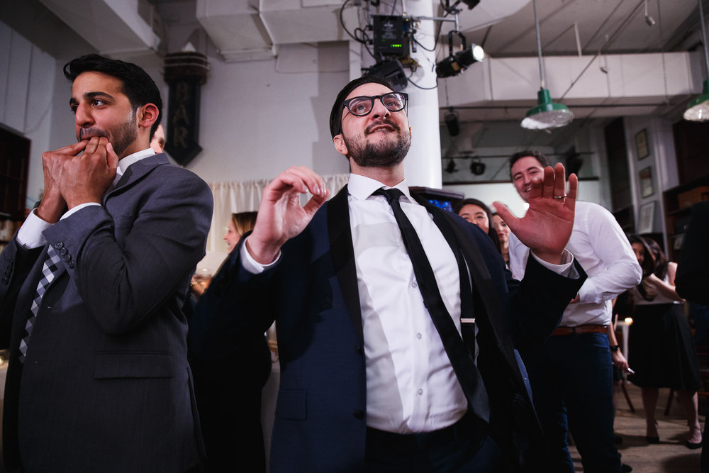 Groom breaks it down on the dance floor while his friend whistles for more