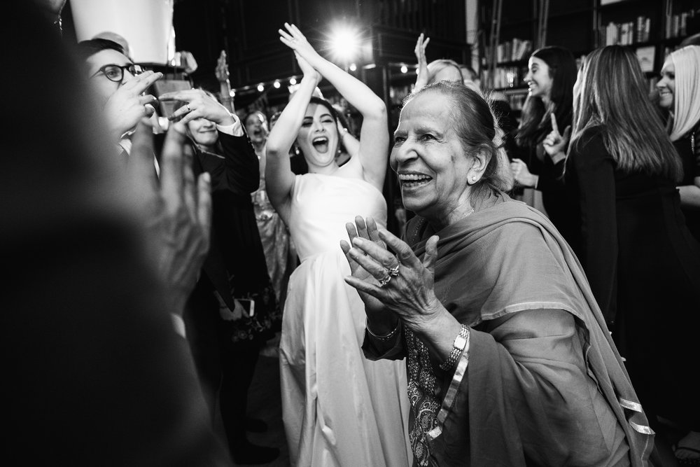 Grandmother of the groom dances on the dance floor and everyone cheers