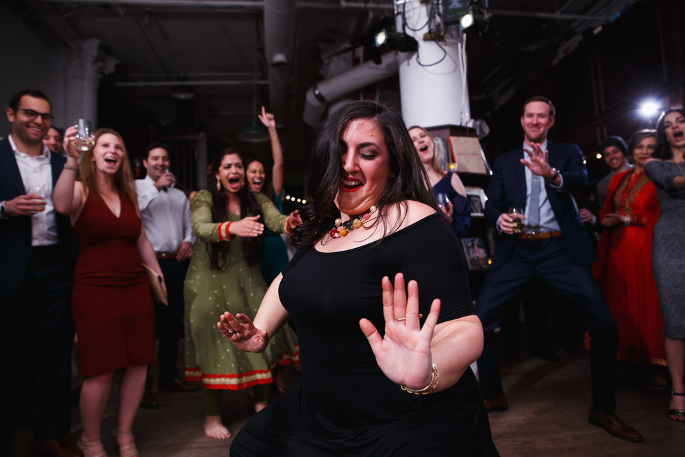 wedding guest gets down on the dance floor at housing works bookstore