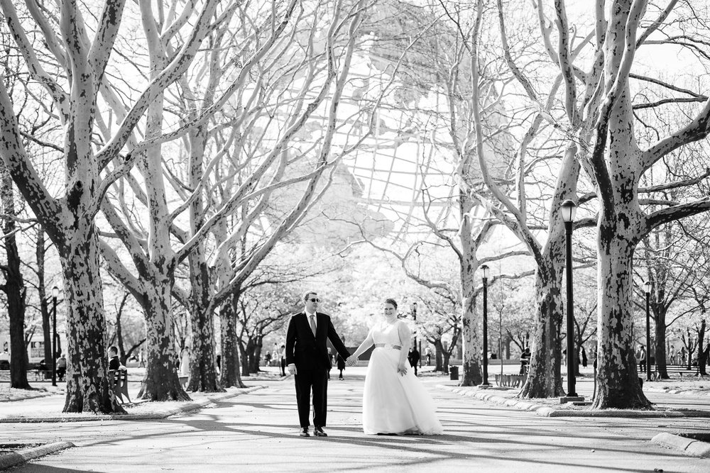 bride and groom in front of the worlds fair globe in flushing meadows corona park