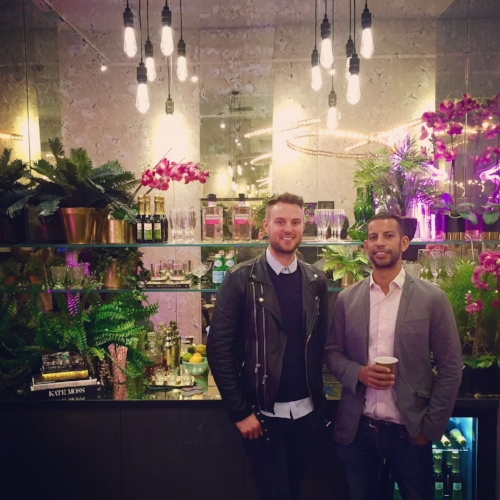 The Curious Department's co-founders Ross and Chris, posing infront of the styled bar area at the A/W Launch Party