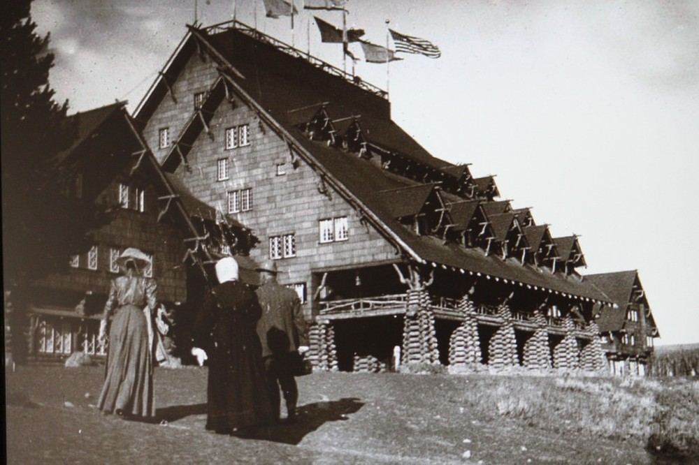 Photo 2: Historic photo of the Inn, ca. 1904. Photo from Old Faithful Inn: Then and Now. This photo was taken before the porte-cochere was extended as shown to the right of the current photo of the Inn.