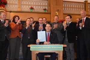 Wisconsin Governor Scott Walker signs 2013 Wisconsin Act 62 into law at the Hotel Northland in Green Bay. Photo via The Daily Reporter.