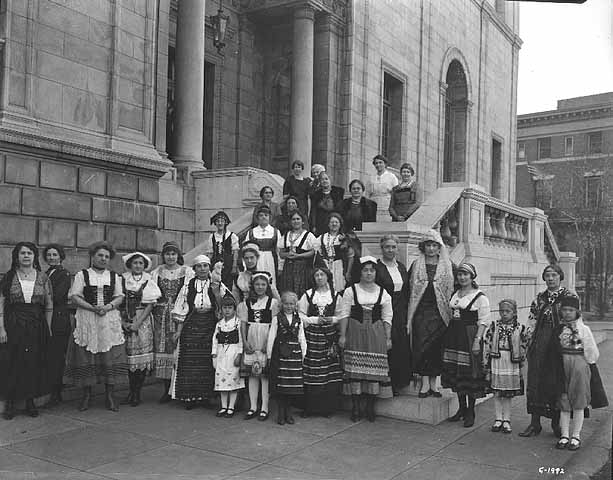 Women dressed in ethnic costume, standing on steps of St. Paul Public Library. 1039-B (Negative Number).jpg