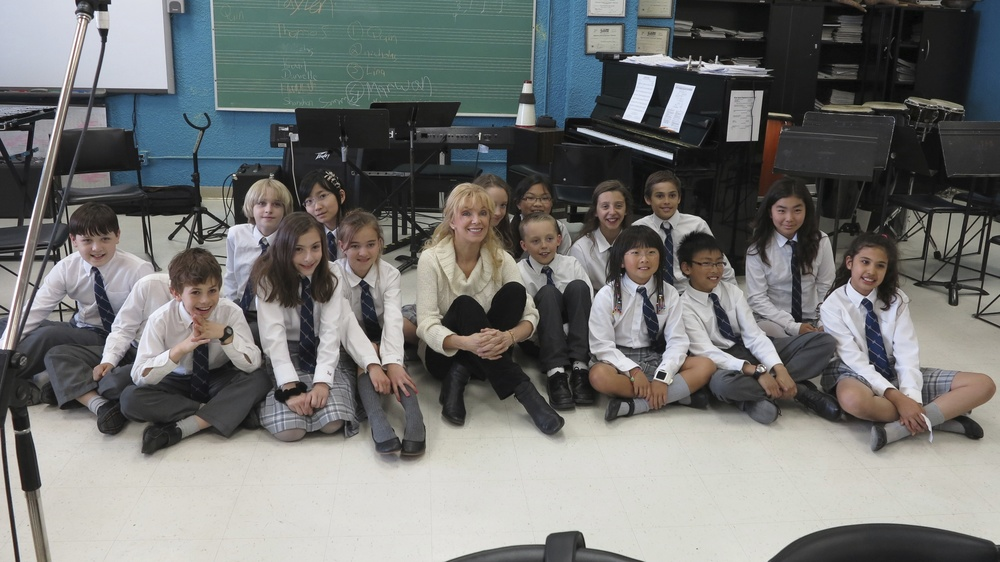 "Liona sitting with a choir of children at the Toronto French School who sang three French folksongs used on her ""The Return...to Canada with Love"" album."