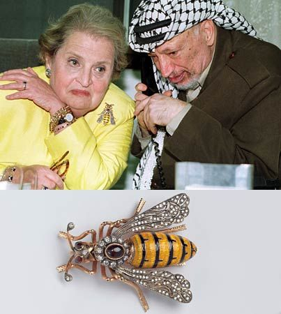 Yasser Arafat and Albright speaking by phone with President Clinton.  Albright spent many hours wrangling with the Palestinian leader about the need for compromise in the Middle East.  Her pin reflected her mood.