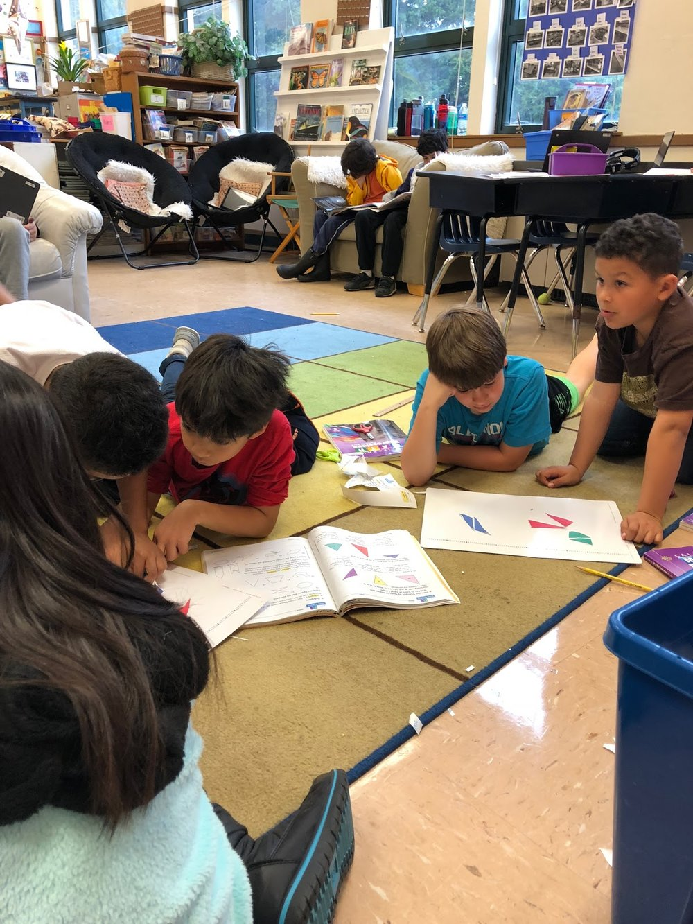 Students figuring it out together in the classroom.