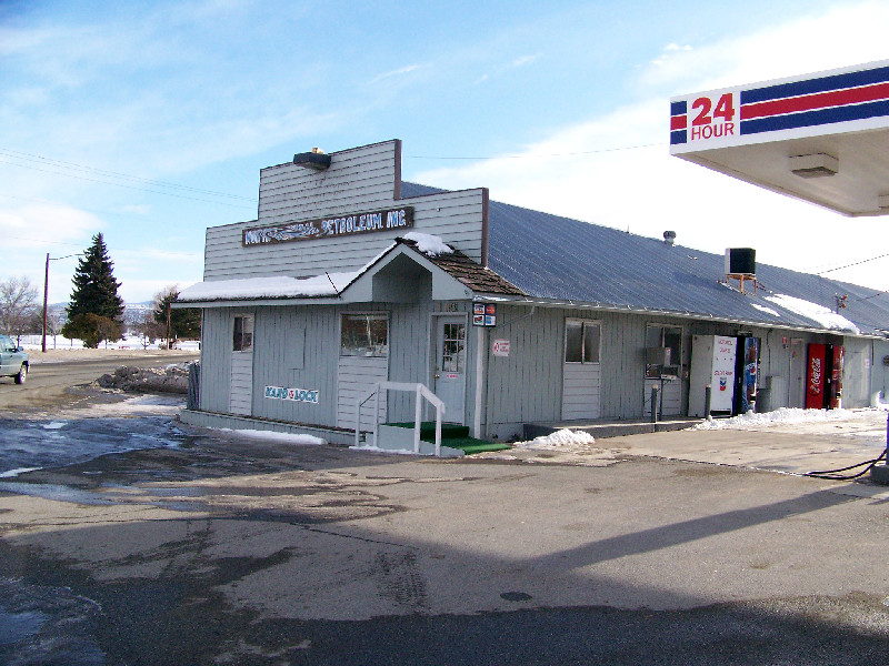A photo of office space in Omak, available for rent. This space is situated next to a fueling station.