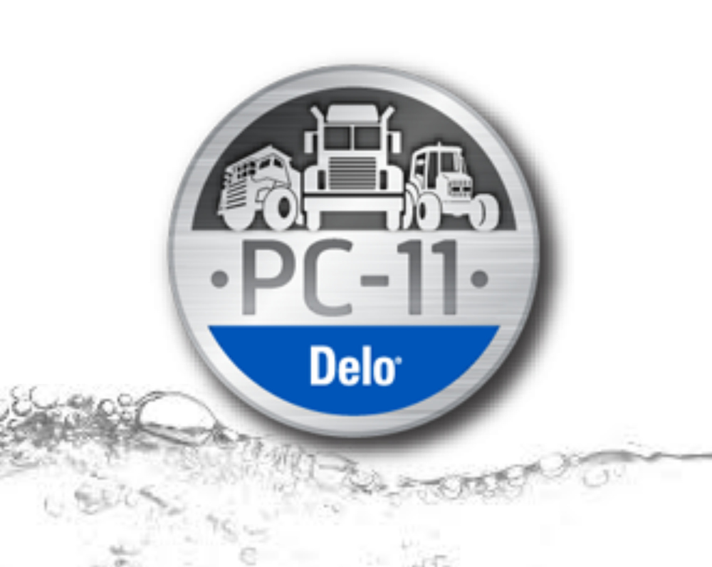 This is a photo of the PC-11 logo from Chevron. The logo features a graphic of a fire truck, a semi truck, and a tractor with the words PC-11 and Delo. This image serves as a link to Chevron's information page about a new product line called PC-11.