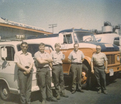 Five Coleman Oil Employees gather outside the office, circa 1960.
