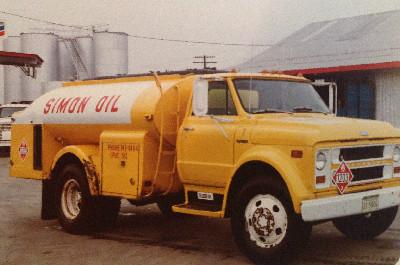 A yellow Simon Oil Truck. Coleman Oil acquired Simon Oil in 1977.