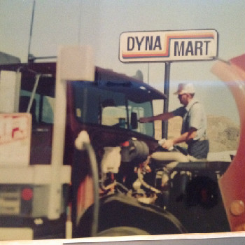 A truck driver fills up his tank at Dyna Mart.