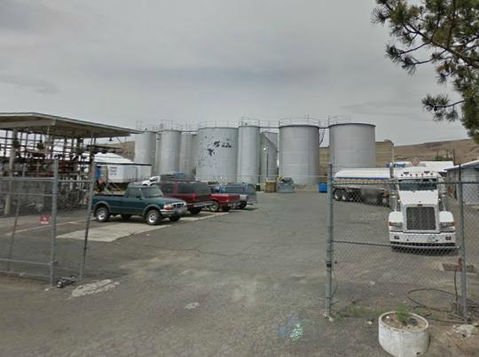 Bulk tanks and a truck and trailer parked at Wondrack Distributing in Kennewick, WA. Coleman Oil acquired Wondrack Distributing in 2015.